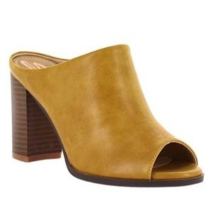 Size 6 mustard clog heel with peep toe. NWT!